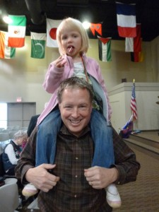 We get shoulder rides from Papa Bill and lollipops at this church!