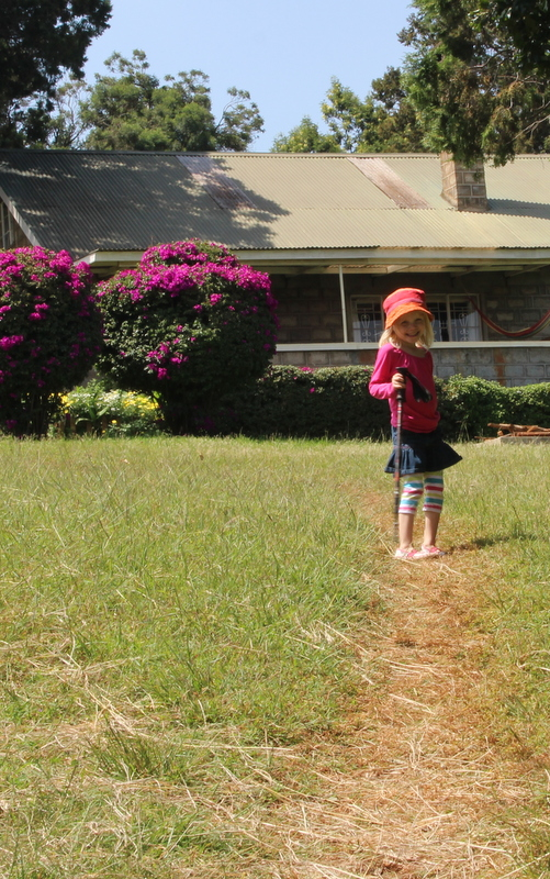 Riley, on a daddy-daughter walk to get a closer look at a colobus monkey we saw in our front yard!