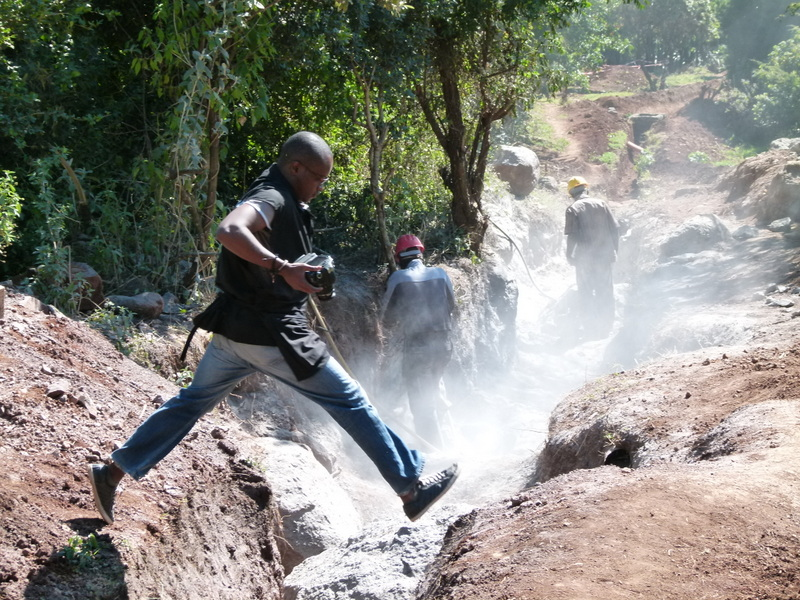 Breaking rocks to lay the main effluent discharge pipe (July 2012)
