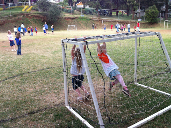 Riley and her friend Ella, demonstrating outstanding goalie awareness during a soccer game this week.  Or was it foosball?