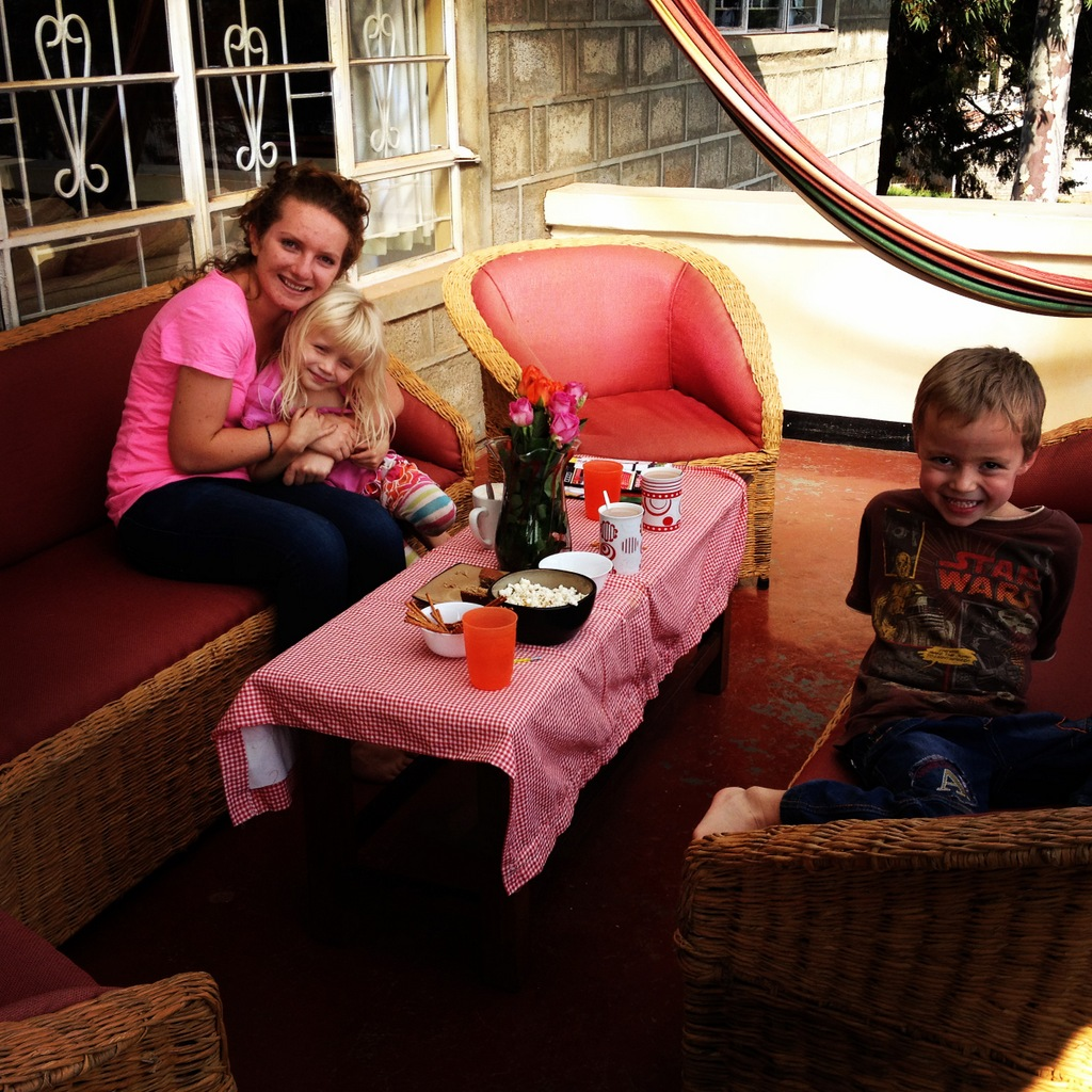 """Reunion:  Riley's """"Big Sister"""" from last year, Hanna Joy, back in Kenya for a visit from Germany.   Tea party time!"""