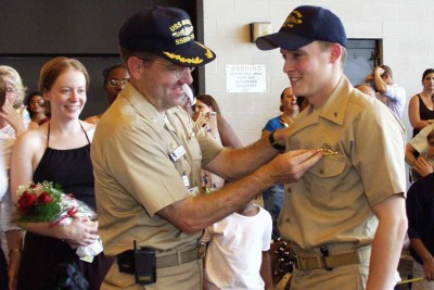 Getting my 'dolphins' (submarine warfare qualification pin) pinned on by Commanding Officer Joe Tofalo