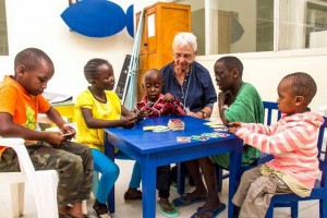 Volunteer Susan O'Neill plays with some of our precious kids in the new play room.