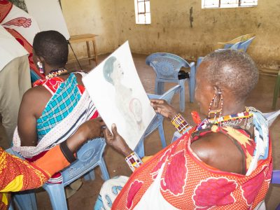 Training Maasai Community Health Volunteers with simple diagrams and tools.
